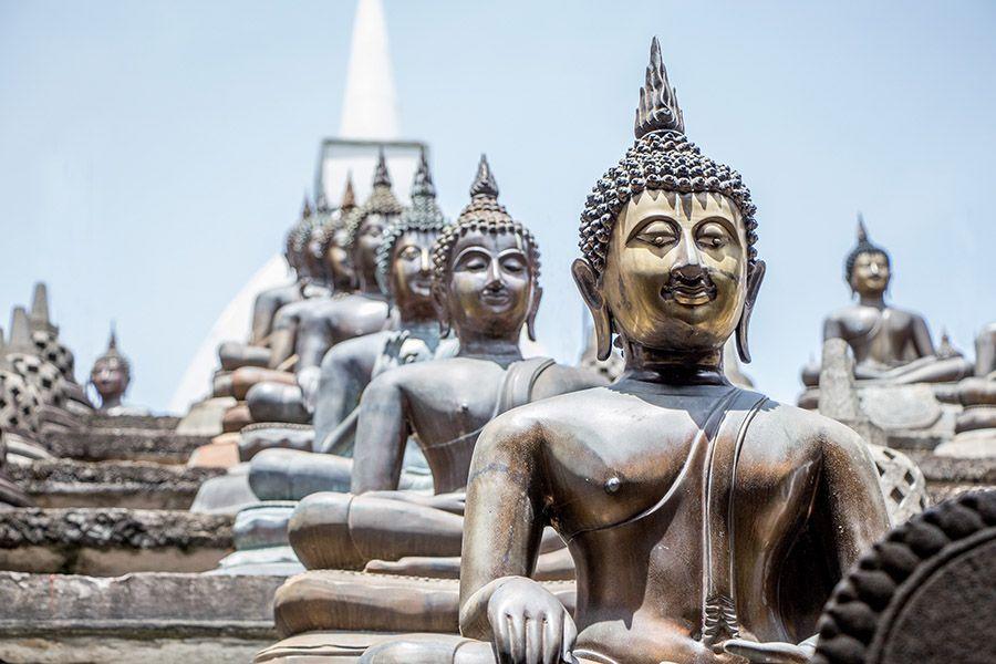 Buddha statues, Gangaramaya temple, Colombo, Sri Lanka
